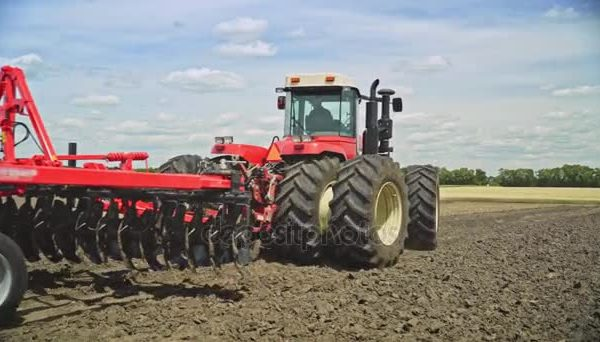depositphotos_177785918-stock-video-farming-tractor-plowing-field-farming